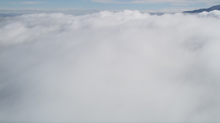 5K stock footage aerial video tilt up and fly over thick cloud cover in Southern California  Aerial Stock Footage | AX0010_077