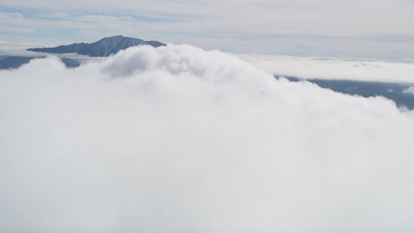 5K stock footage aerial video orbit a large white cloud near a mountain peak in the San Jacinto Mountains, California Aerial Stock Footage | AX0010_078