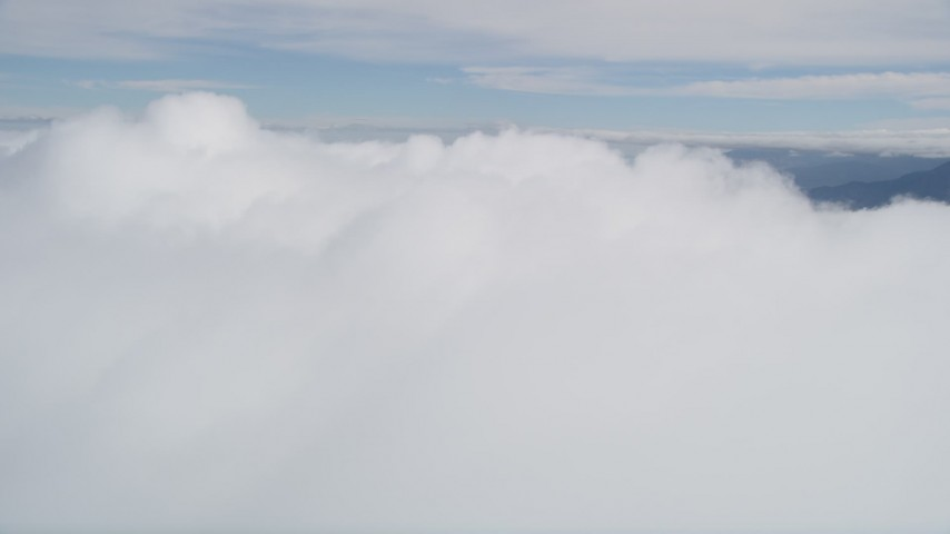 5K stock footage aerial video fly over thick cloud cover in Southern California Aerial Stock Footage | AX0010_079