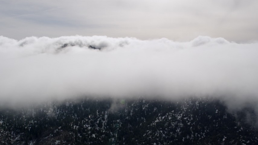 5K stock footage aerial video of approaching thick cloud cover over Southern California Aerial Stock Footage | AX0010_088