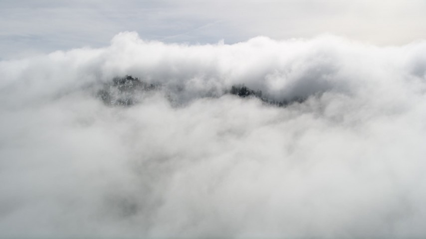 5K stock footage aerial video approach mountain summit covered by clouds in the San Jacinto Mountains, California Aerial Stock Footage | AX0010_091