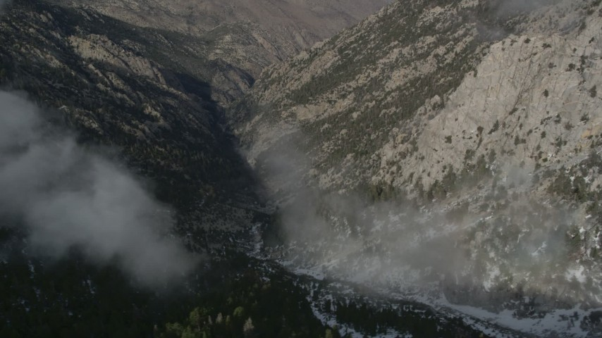 5K aerial video orbit a canyon with light winter snow in the San Jacinto Mountains, California Aerial Stock Footage | AX0010_097