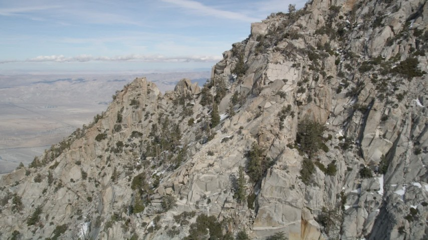 5K stock footage aerial video fly over mountain slopes with small patches of snow in the San Jacinto Mountains, California Aerial Stock Footage | AX0010_098E