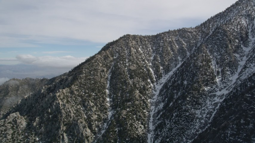 5K stock footage aerial video orbit peak with winter snow in the San Jacinto Mountains, California Aerial Stock Footage | AX0010_100