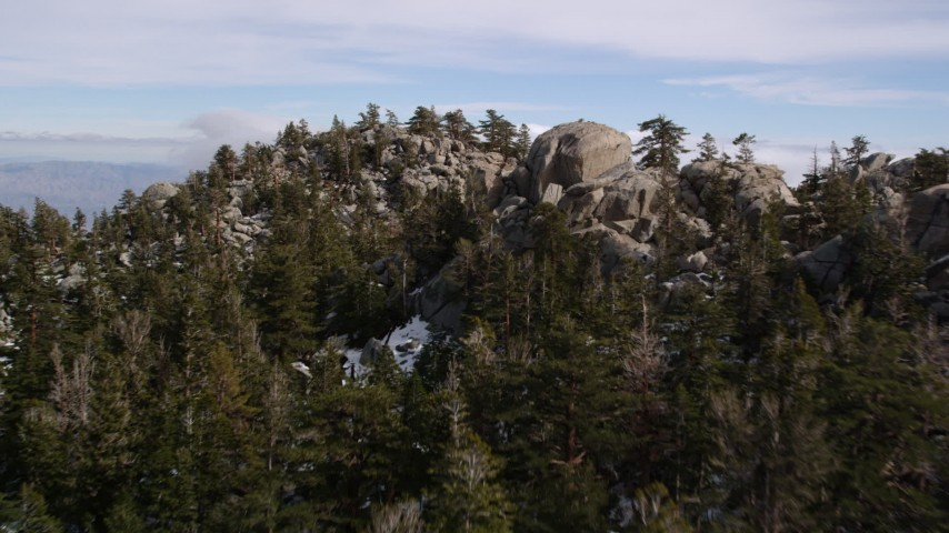 5K aerial video fly over rocky slopes with small patches of snow in the San Jacinto Mountains, California Aerial Stock Footage | AX0010_104
