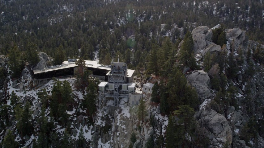 5K stock footage aerial video of circling a mountain tram station in the San Jacinto Mountains with winter snow, California Aerial Stock Footage | AX0010_109
