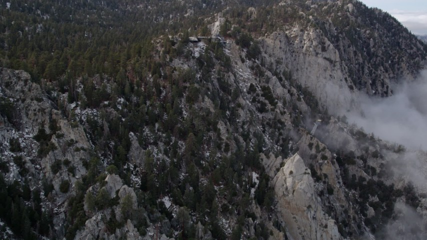5K stock footage aerial video tilt to reveal and approach a tram station in the San Jacinto Mountains, California Aerial Stock Footage | AX0010_111