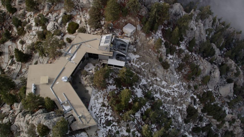 5K stock footage aerial video approach tram station and tilt to bird's eye view in the San Jacinto Mountains, California Aerial Stock Footage | AX0010_112
