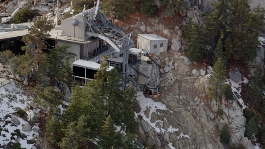 5K stock footage aerial video orbit a gondola at a mountaintop tram station in the San Jacinto Mountains in winter, California Aerial Stock Footage | AX0010_117