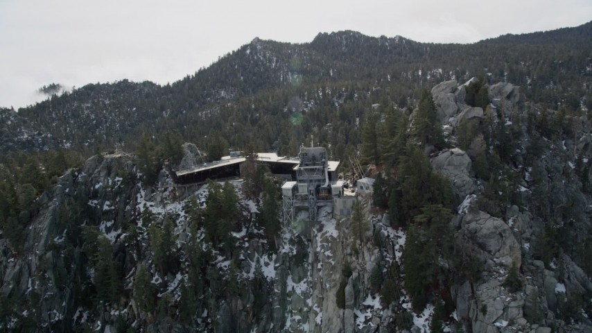 5K stock footage aerial video of orbiting a mountaintop tram station in the San Jacinto Mountains with light snow, California Aerial Stock Footage | AX0010_119E