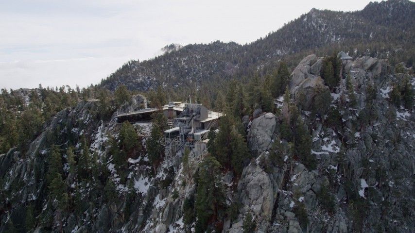 5K stock footage aerial video of circling a tram station with patches of light snow in the San Jacinto Mountains, California Aerial Stock Footage | AX0010_120