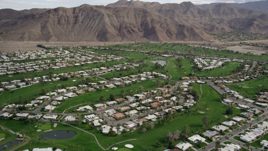 5K stock footage aerial video orbit homes and golf course in West Palm Springs, California Aerial Stock Footage | AX0010_132