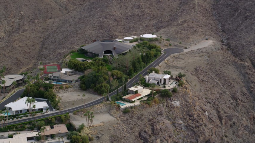 5K stock footage aerial video orbiting a group of hilltop mansions in West Palm Springs, California Aerial Stock Footage | AX0010_136