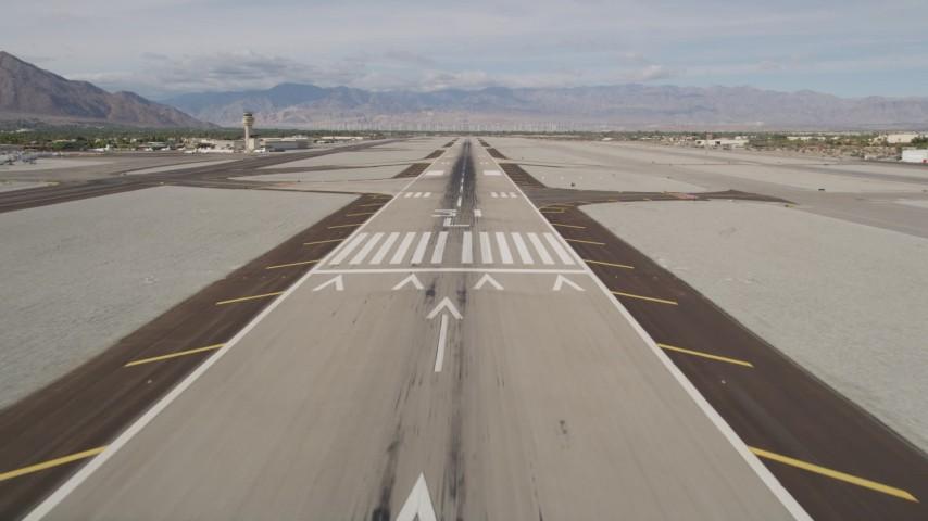 5K stock footage aerial video of descending toward runway at Palm Springs International Airport, California Aerial Stock Footage | AX0010_145
