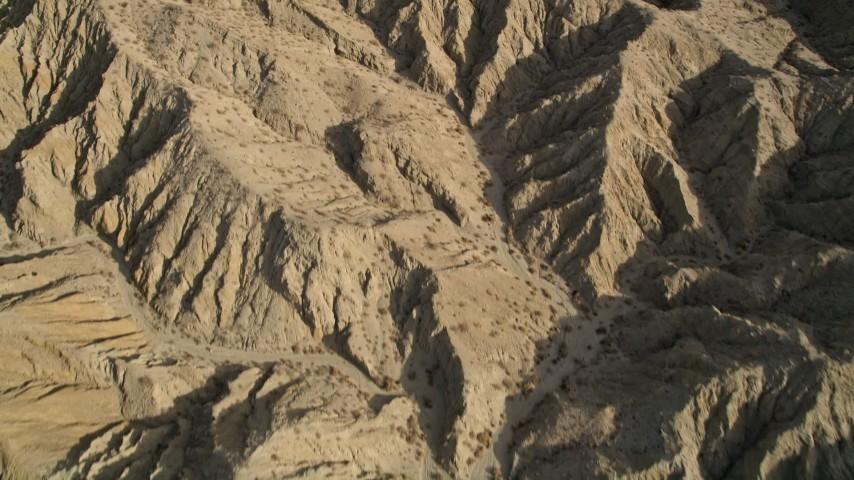 5K aerial video bird's eye view of an arid mountain range in the Mojave Desert, California Aerial Stock Footage | AX0011_003