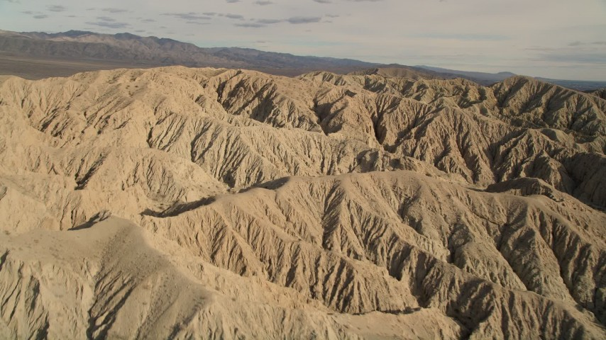 5K stock footage aerial video fly over and orbit arid desert mountains in the Mojave Desert, California Aerial Stock Footage | AX0011_005
