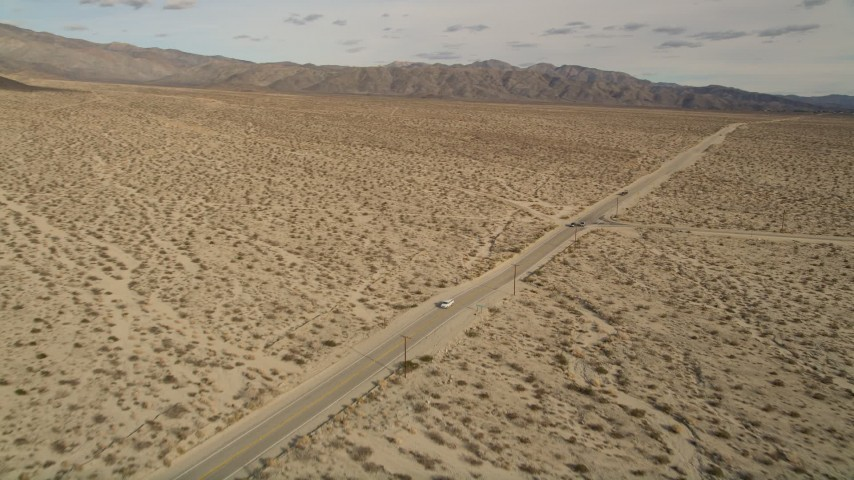 5K aerial video orbit lonely desert highway in Joshua Tree National Park, California Aerial Stock Footage AX0011_006