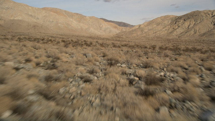 5K stock footage aerial video of low altitude approach to desert mountains in Joshua Tree National Park, California Aerial Stock Footage | AX0011_015