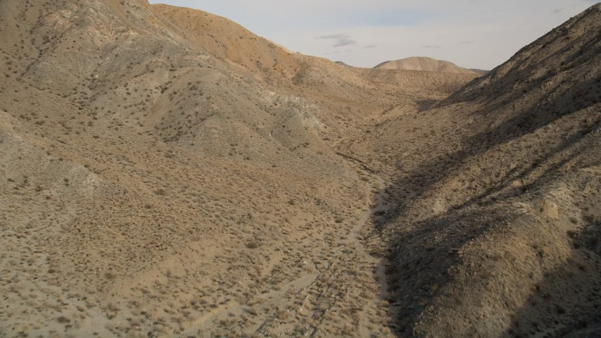 5K stock footage aerial video of a canyon between desert mountains in Joshua Tree National Park, California Aerial Stock Footage | AX0011_018E