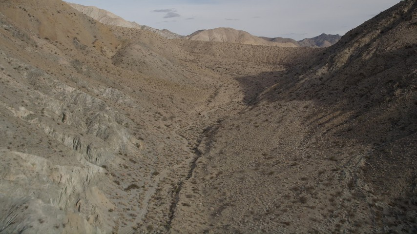 5K stock footage aerial video fly over a canyon between desert mountains in Joshua Tree National Park, California Aerial Stock Footage | AX0011_019