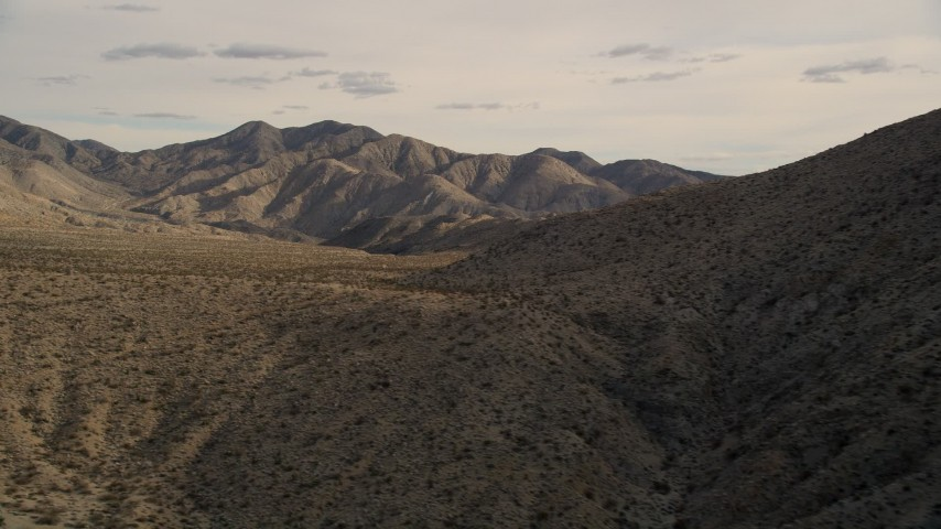 5K stock footage aerial video of flying by desert mountains in Joshua Tree National Park, California Aerial Stock Footage | AX0011_020