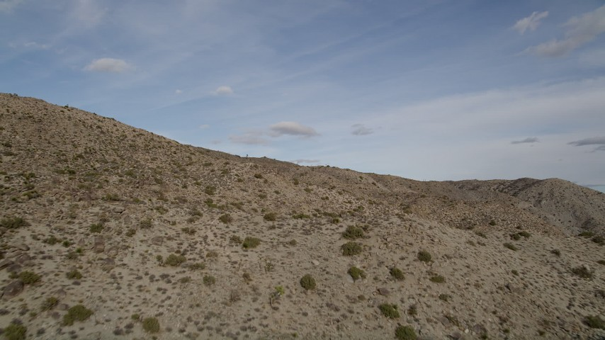 5K stock footage aerial video fly low over desert mountain slope, Joshua Tree National Park, California Aerial Stock Footage | AX0011_023