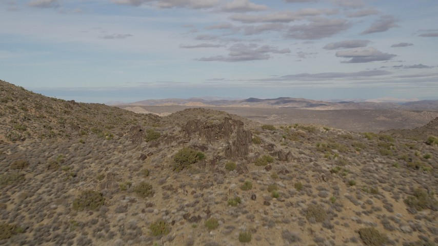 5K stock footage aerial video of flying over a rock formation, Joshua Tree National Park, California Aerial Stock Footage | AX0011_028