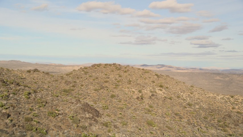 5K stock footage aerial video of flying over a rock formation, Joshua Tree National Park, California Aerial Stock Footage | AX0011_028E