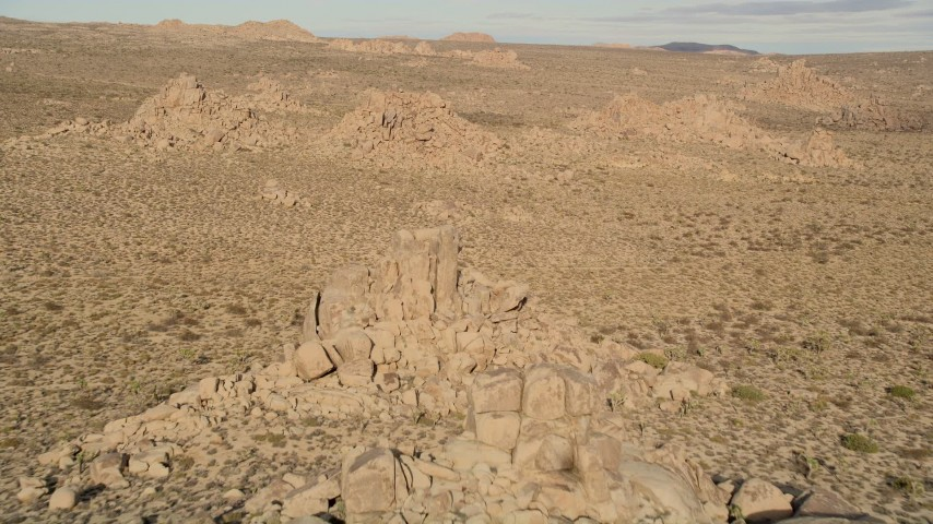 5K stock footage aerial video of descending toward rock formations, Joshua Tree National Park, California Aerial Stock Footage | AX0011_030