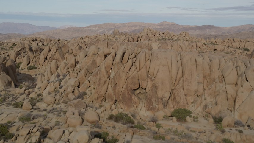5K stock footage aerial video fly over rock formations, Joshua Tree National Park, California Aerial Stock Footage | AX0011_039