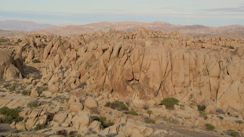 5K stock footage aerial video fly over rock formations, Joshua Tree National Park, California Aerial Stock Footage | AX0011_039E
