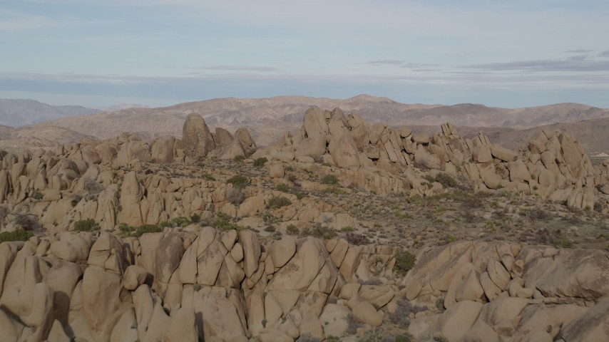 5K stock footage aerial video fly over rock formations, Joshua Tree National Park, California Aerial Stock Footage | AX0011_040