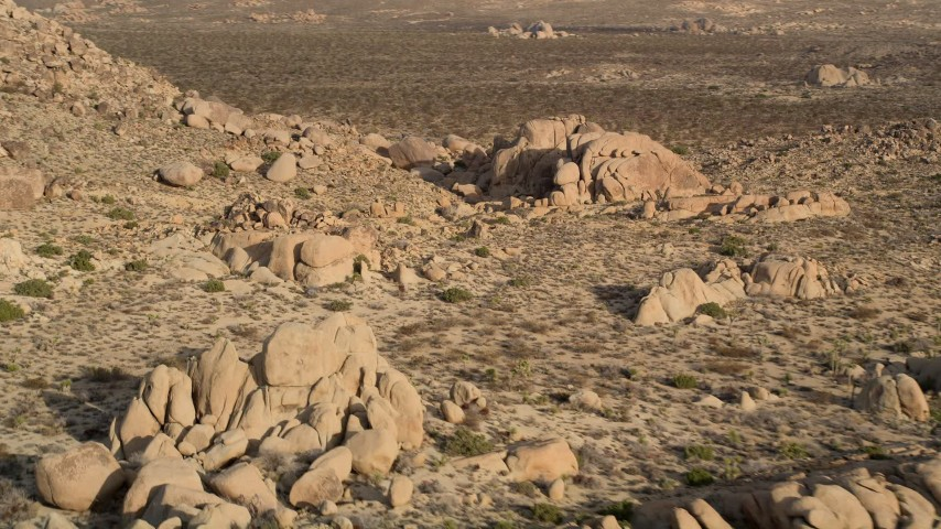 5K stock footage aerial video of flying by rock formations, Joshua Tree National Park, California Aerial Stock Footage | AX0011_042