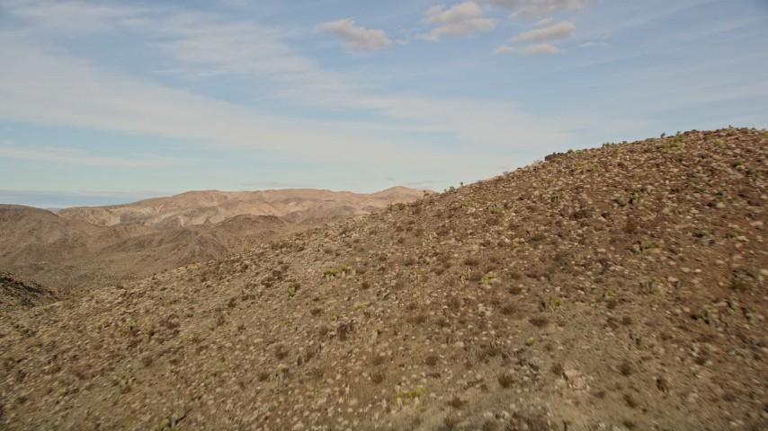 5K stock footage aerial video reveal a desert mountain range, Mojave Desert, California Aerial Stock Footage | AX0011_047