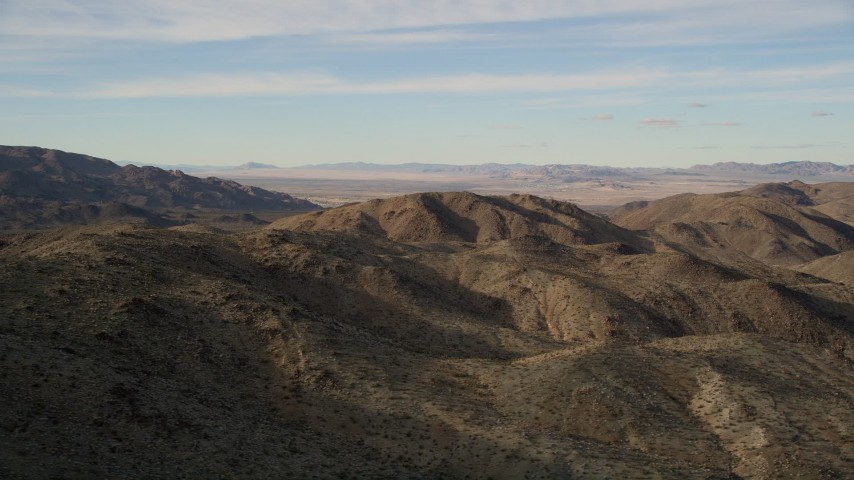 5K aerial video fly by desert mountains, Mojave Desert, California Aerial Stock Footage   AX0011_048