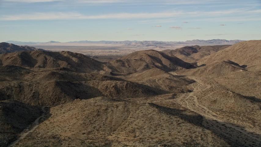 5K stock footage aerial video flyby desert mountains, Mojave Desert, California Aerial Stock Footage | AX0011_049