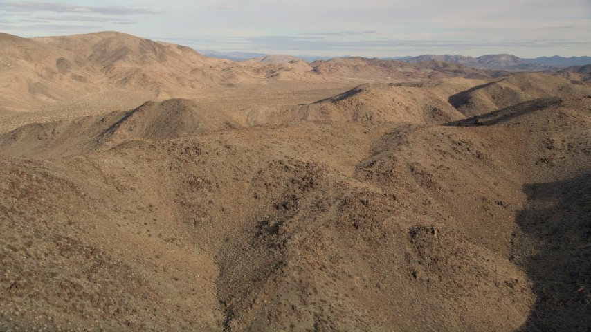5K stock footage aerial video orbiting desert mountains, Mojave Desert, California Aerial Stock Footage | AX0011_050