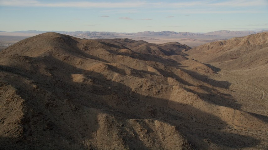 5K stock footage aerial video of flying along desert mountains, Mojave Desert, California Aerial Stock Footage | AX0011_051