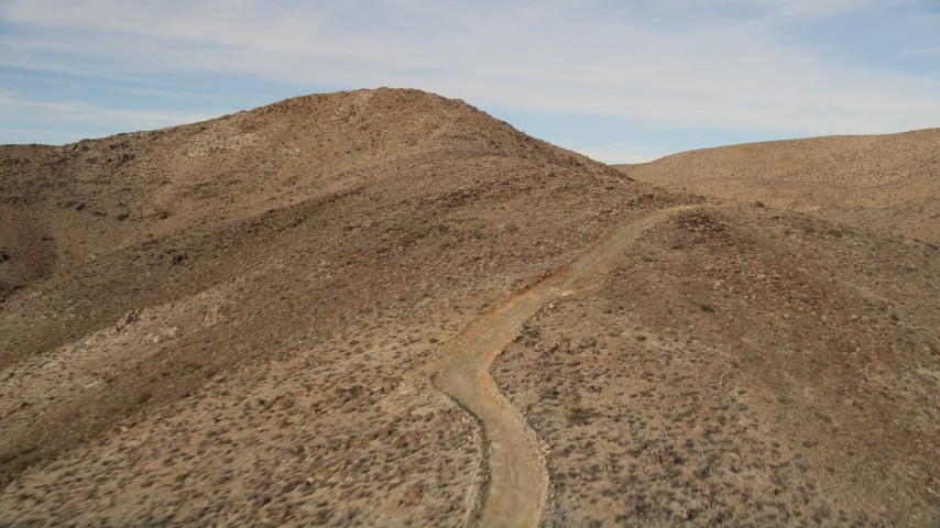 5K stock footage aerial video of a mountain road in Mojave Desert, California Aerial Stock Footage | AX0011_053E