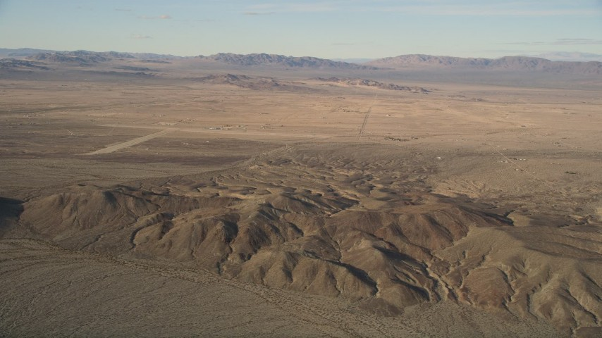 5K stock footage aerial video of desert hills and rural areas, Mojave Desert, California Aerial Stock Footage   AX0011_059