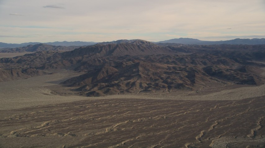 5K stock footage aerial video of desert mountains and plains, Mojave Desert, California Aerial Stock Footage | AX0011_062