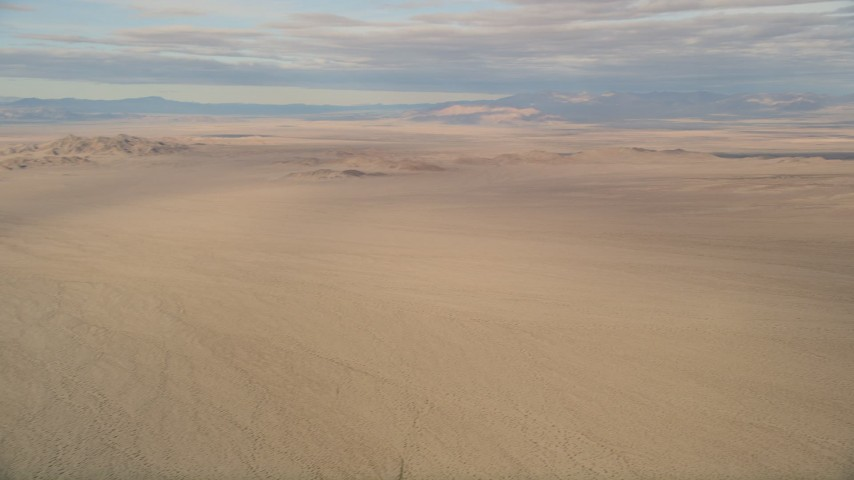 5K stock footage aerial video of desert plains and mountains, Mojave Desert, California Aerial Stock Footage   AX0011_069