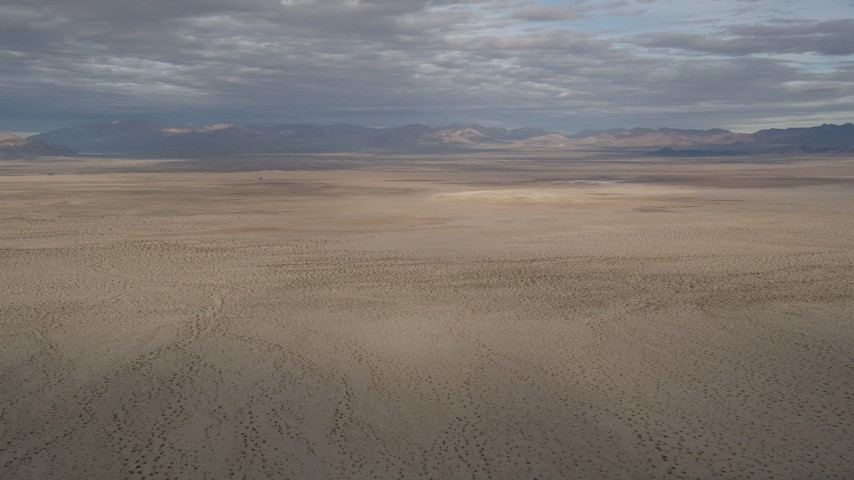 5K aerial video of an open plain in the Mojave Desert, California Aerial Stock Footage | AX0011_071