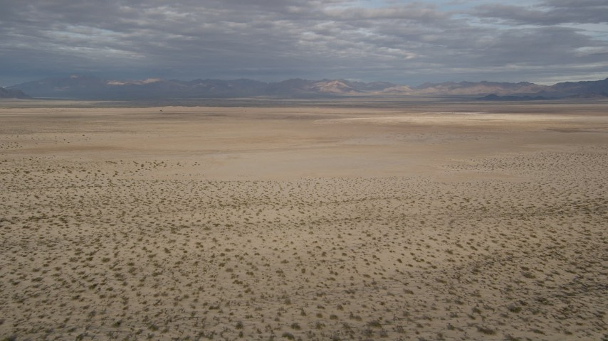 5K stock footage aerial video fly low over open desert, Mojave Desert, California Aerial Stock Footage AX0011_072