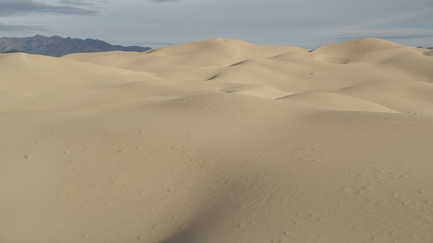 5K aerial video fly low over sand dunes, Kelso Dunes, Mojave Desert, California Aerial Stock Footage | AX0012_007