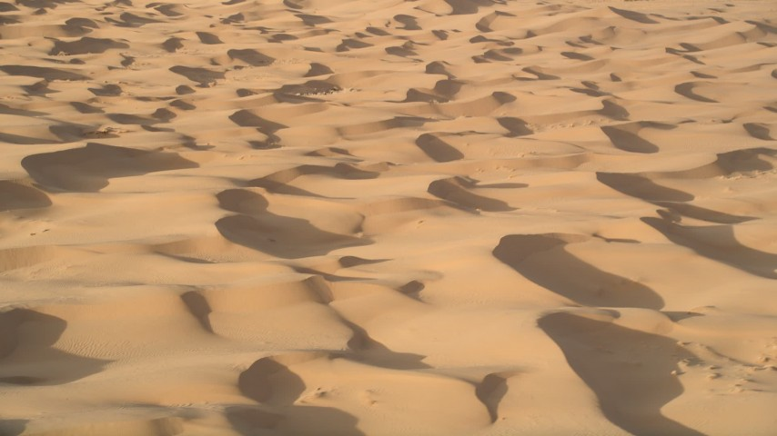 5K aerial video fly across sand dunes, Kelso Dunes, Mojave Desert, California Aerial Stock Footage | AX0012_010