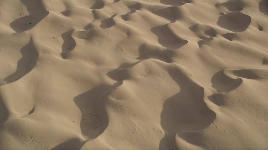 5K aerial video of sand dunes, Kelso Dunes, Mojave Desert, California Aerial Stock Footage | AX0012_018