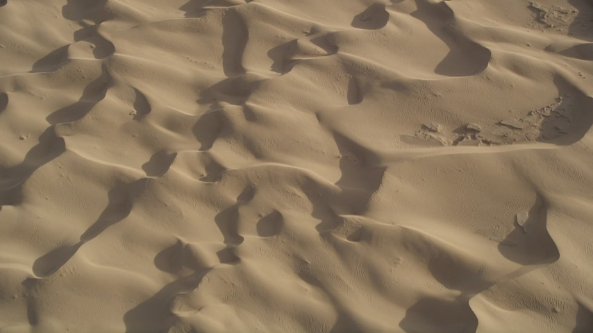 5K stock footage aerial video fly over sand dunes, Kelso Dunes, Mojave Desert, California Aerial Stock Footage | AX0012_019