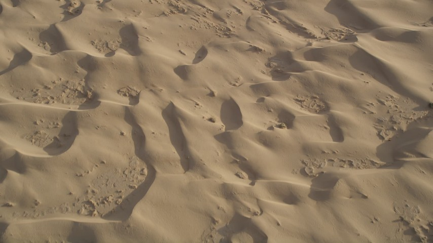 5K aerial video fly over sand dunes, Kelso Dunes, Mojave Desert, California Aerial Stock Footage | AX0012_020