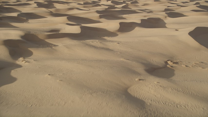 5K stock footage aerial video fly over sand dunes, Kelso Dunes, Mojave Desert, California Aerial Stock Footage | AX0012_023